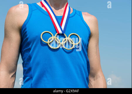 RIO DE JANEIRO - FEBRUARY 4, 2016: Olympic rings gold medal hangs from red, white, and blue USA colors ribbon on - Stock Photo