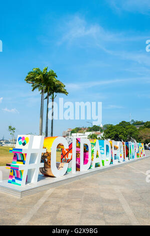 RIO DE JANEIRO - FEBRUARY 25, 2016: Large colorful sign #CIDADEOLIMPICA (Olympic city) stands in Maua Plaza. - Stock Photo