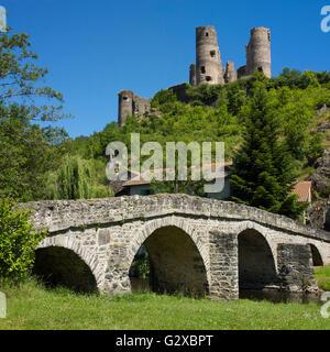 Old stone bridge in front of Château de Domeyrat castle, Domeyrat, Haute-Loire department, Auvergne, France - Stock Photo