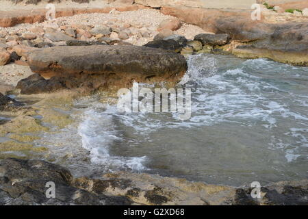 Movement of waves against rocks at la Mola beach, Formentera - Stock Photo