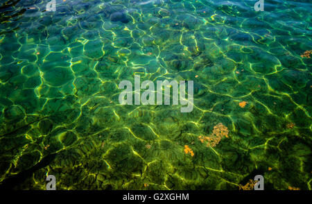 Crystal Clean Pristine Waters Of The Great Lakes. The sun reflects off the aquamarine waters of Lake Huron. - Stock Photo