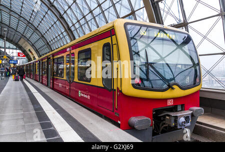 S Bahn train pulls into Berlin Hauptbahnhof Station,Berlin's main Railway station,The S Bahn is one of many services - Stock Photo