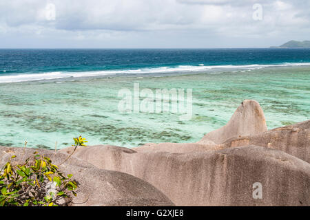 View from a large formation of granite rock at the famous Anse Source D'Argent in La Digue, Seychelles - Stock Photo