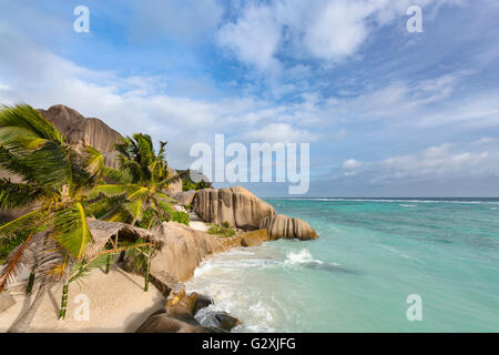 The famous wedding ceremony spot at Anse Source D'Argent in La Digue, Seychelles with scenic granite rocks in evening - Stock Photo