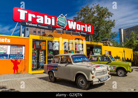Trabant cars near the remains of The Berlin Wall , Berlin , Germany - Stock Photo