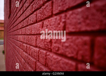 Abstract view of a painted red brick wall. Digital background or wallpaper with lines and tension. - Stock Photo