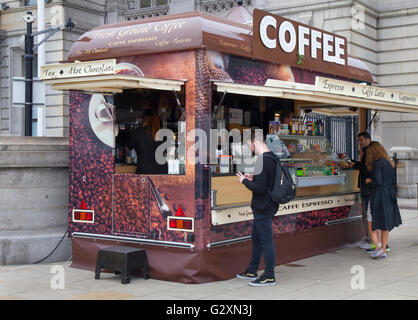 Coffee van, outside, man, crowds, tourists, day-trippers, visitors and tourists, visit the tall ships event in dockland - Stock Photo