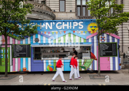 Fish & Chips, Fish and Chip shop vendor, Chippie open for business as Crowds, tourists, day-trippers, visitors and - Stock Photo
