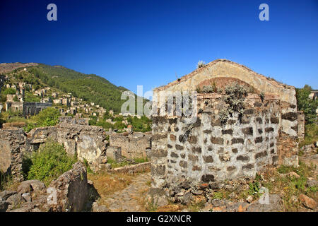 Partial view of  the 'ghost village' of Kayakoy Lycia, Mugla province, Turkey. - Stock Photo