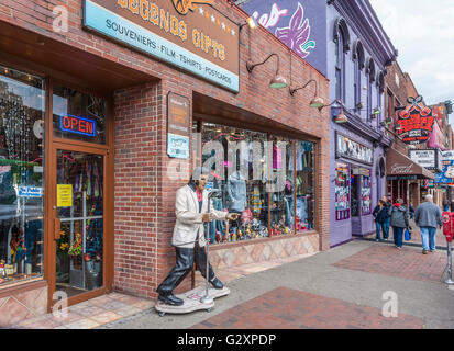 Statue of Elvis Presley on sidewalk outside of Legends Gifts store on Broadway in downtown Nashville, Tennessee - Stock Photo