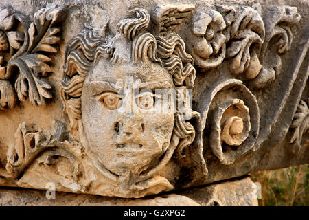 Bas relief of Medusa head at the archaeological site of ancient Myra, Demre, Lycia, Antalya province, Turkey. - Stock Photo