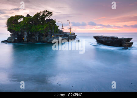 Pura Tanah Lot at sunset, famous ocean temple in Bali, Indonesia. - Stock Photo