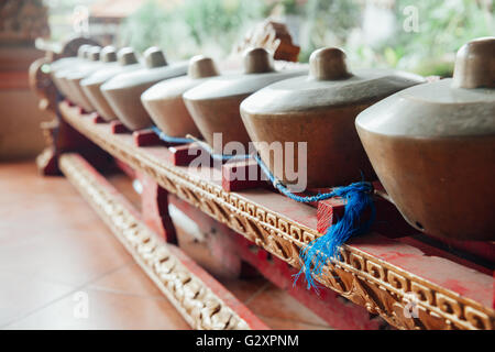 Traditional balinese percussive music instruments instruments for 'Gamelan' ensemble music, Ubud, Bali, Indonesia. - Stock Photo