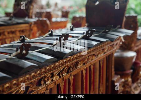Traditional balinese percussive music instruments for 'Gamelan' ensemble music, Ubud, Bali, Indonesia. - Stock Photo