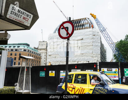 Building and construction work at the junction of St. Martin's Street  and Orange Street in London's Soho, UK - Stock Photo