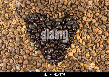 Bunch of Roasted coffee beans forming background - Stock Photo