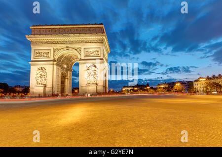 The famous Arc de Triomphe in Paris at dawn - Stock Photo