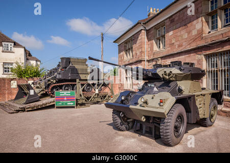 A FV721 Fox armoured car and a FV180 Combat Engineer Tractor outside the Headquarters and Museum of the Royal Monmouthshire... - Stock Photo
