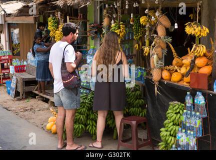 Sri Lanka, Ella, tourists shopping in fruit and vegetable market - Stock Photo