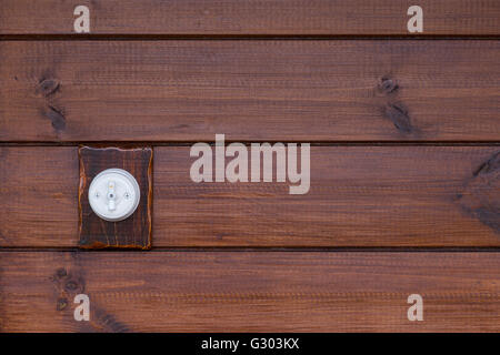 Retro light switch on wooden background - Stock Photo