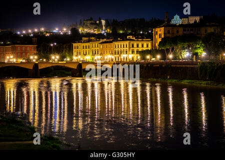 Ponte Vecchio and Arno river in Florence. Historical view of Italy at night - Stock Photo