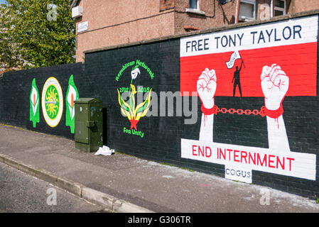 Belfast murals in a republican area, calling on the Derry Republican Tony Taylor to be freed after being returned - Stock Photo