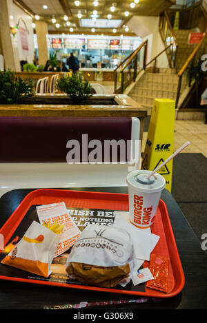 Hamburger, fries and drink on a tray in a Burger King fast-food restaurant - Stock Photo