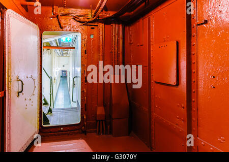 Watertight bulkhead door dividing two compartments on a ship. - Stock Photo
