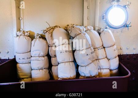 Seamen duffle bags and hammocks on HMS Caroline, Belfast, the last surviving ship from the Battle of Jutland. - Stock Photo