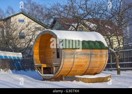 VILNIUS, LITHUANIA - JANUARY 02, 2016: Popular rural mobile wooden bath in the form of a barrel in a winter rustic - Stock Photo