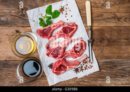 Raw fresh lamb ribs with sauce - Stock Photo