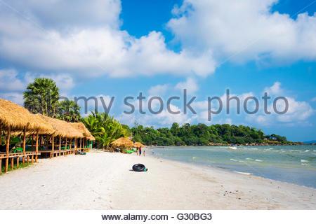 Thatched huts with hammocks along Ochheuteal Beach, Sihanoukville, Preah Sihanouk Province, Cambodia, Indochina, - Stock Photo