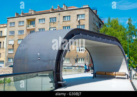 Festina lente, 2012, pedestrian footbridge, crossing Miljacka river, Sarajevo, Bosnia and Herzegovina, Europe - Stock Photo