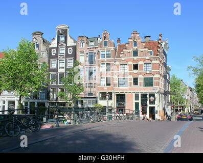 Historic stone bridge and 17th / 18th century houses where Prinsengracht meets Brouwersgracht canal in Amsterdam, - Stock Photo