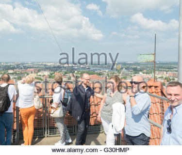St Mary's Church, Gdansk, Poland - People tourists enjoying the views of Gdansk from the 78 metre high tower viewing - Stock Photo
