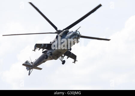 BERLIN / GERMANY - JUNE 3 2016: Czech Mil Mi - 24 Hind attack helicopter flies on ILA in berlin, germany on june - Stock Photo