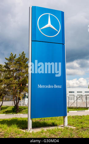 Official dealership sign of Mercedes-Benz in summer sunny day. - Stock Photo