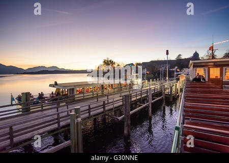 View from a passenger ship at the pier of the Fraueninsel in the Chiemsee and the Alps at sunset, Germany, Bayern, - Stock Photo