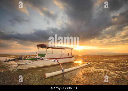 Watching the sun set over Lombok on Gili Lampu Island - Stock Photo