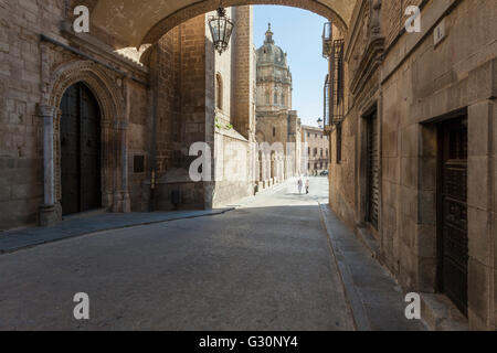 Cobbled street along Toledo cathedral. - Stock Photo
