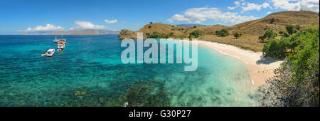 Pink beach on Komodo island in Indonesia - Stock Photo