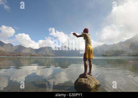 Crater Lake fishing on Mount Rinjani - Stock Photo