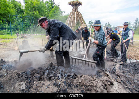 Running, burning,  of a  traditional charcoal kiln in Winterberg-Züschen, Sauerland, Germany, historical way of - Stock Photo