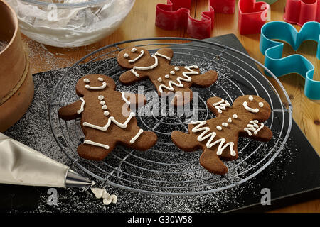 Royal icing on gingerbread men and women - Stock Photo