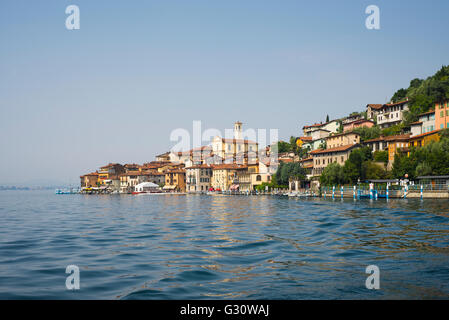 Colorful houses of Peschiera Maraglio on wooded mountain slopes on the shores of the island Monte Isola in Lake - Stock Photo