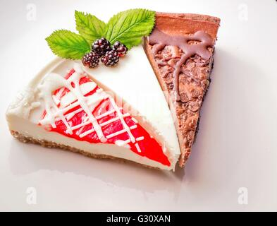 Cheesecake Sampler. Three slices of fresh cheesecake including chocolate, plain and strawberry, - Stock Photo