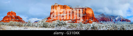 Panoramic view of Courthouse Butte and Bell Rock in Sedona, Arizona after snow storm - Stock Photo