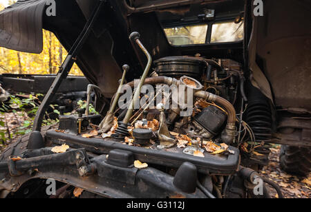 Old truck gear lever. Broken engine compartment - Stock Photo