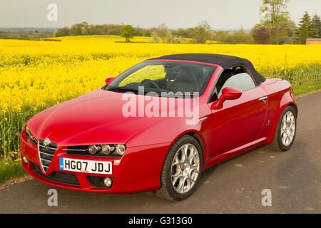 Red Alfa Romeo Sports Car With Red Carpet Stock Photo Alamy - Alfa romeo spider soft top