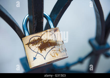 Love relationship breakup, a 'love lock' with its lovers' names scratched out, implying a separation, Budapest, Hungary.